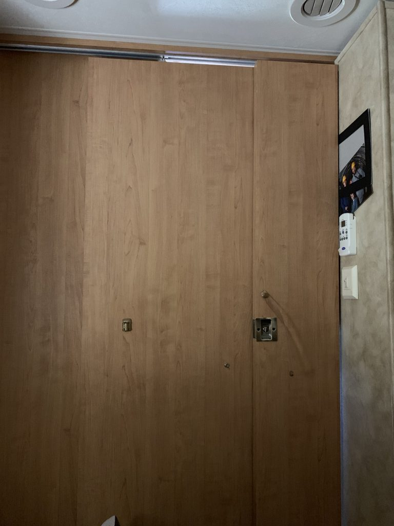 The main bedroom door is folded so it fits the smaller gap