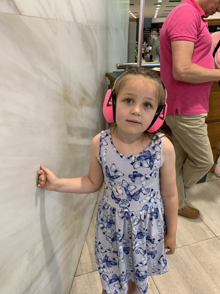 Olivia with ear defenders on at Vatican City