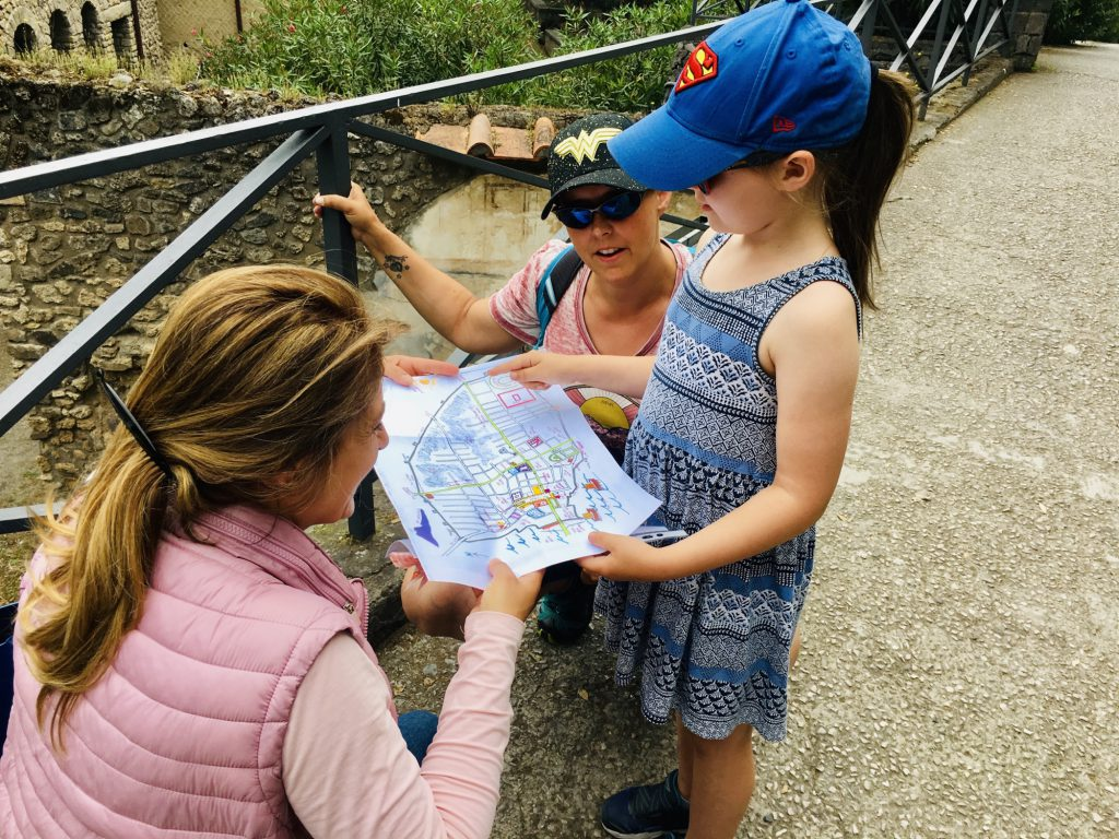 Roberta showing Olivia a map of pompeii