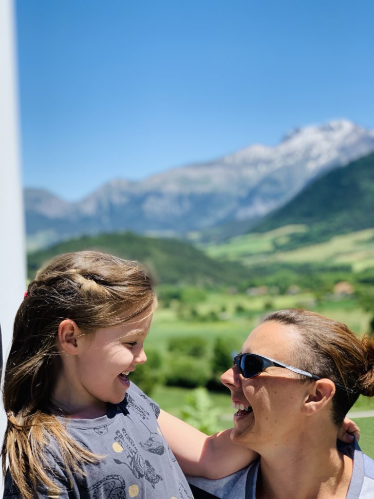 Karen and Olivia in front of the mountains in Lally