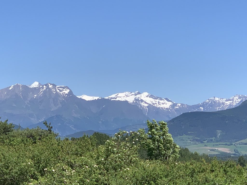 the snow topped mountains in Lally