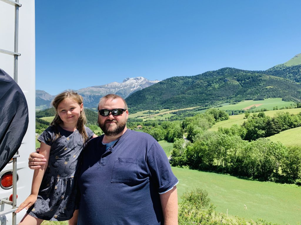 George and Olivia in front of the mountains in Lally
