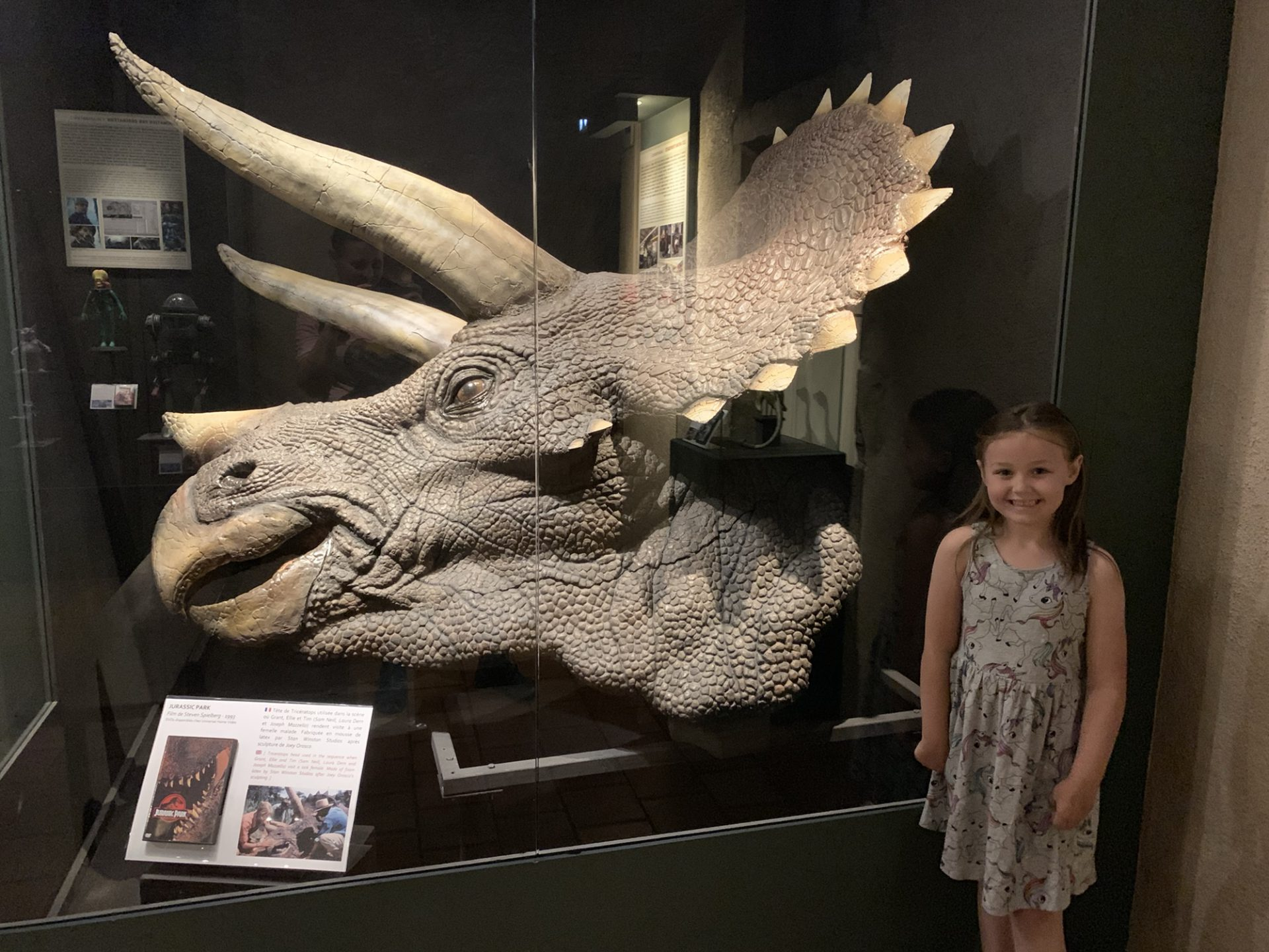 Olivia with the Triceratops head from jurassic park