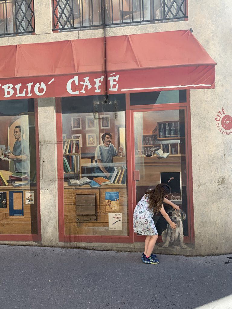 olivia being part of a mural in lyon